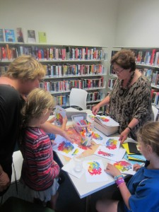 Ann running a painting class at Woollahra library. Image by Woollahra Library.